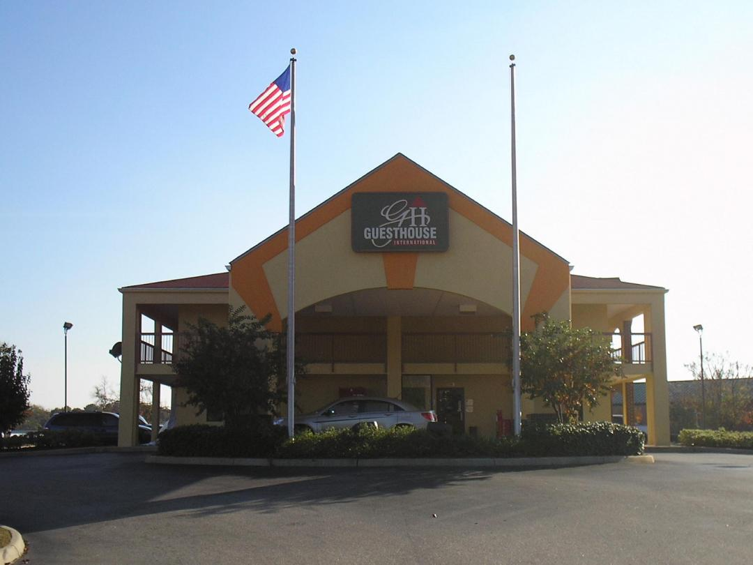 Hotel exterior front entrance with American Flag