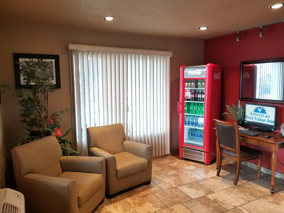 Lobby sitting area, business center, and vending machine