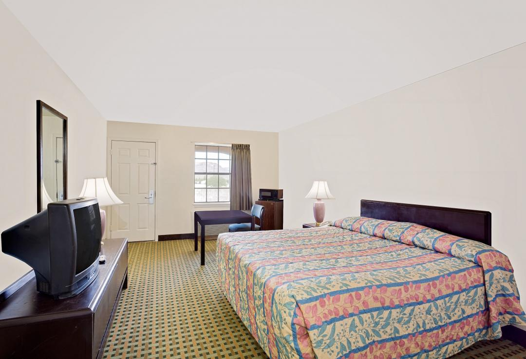 Comfortable guest room with king bed and tv