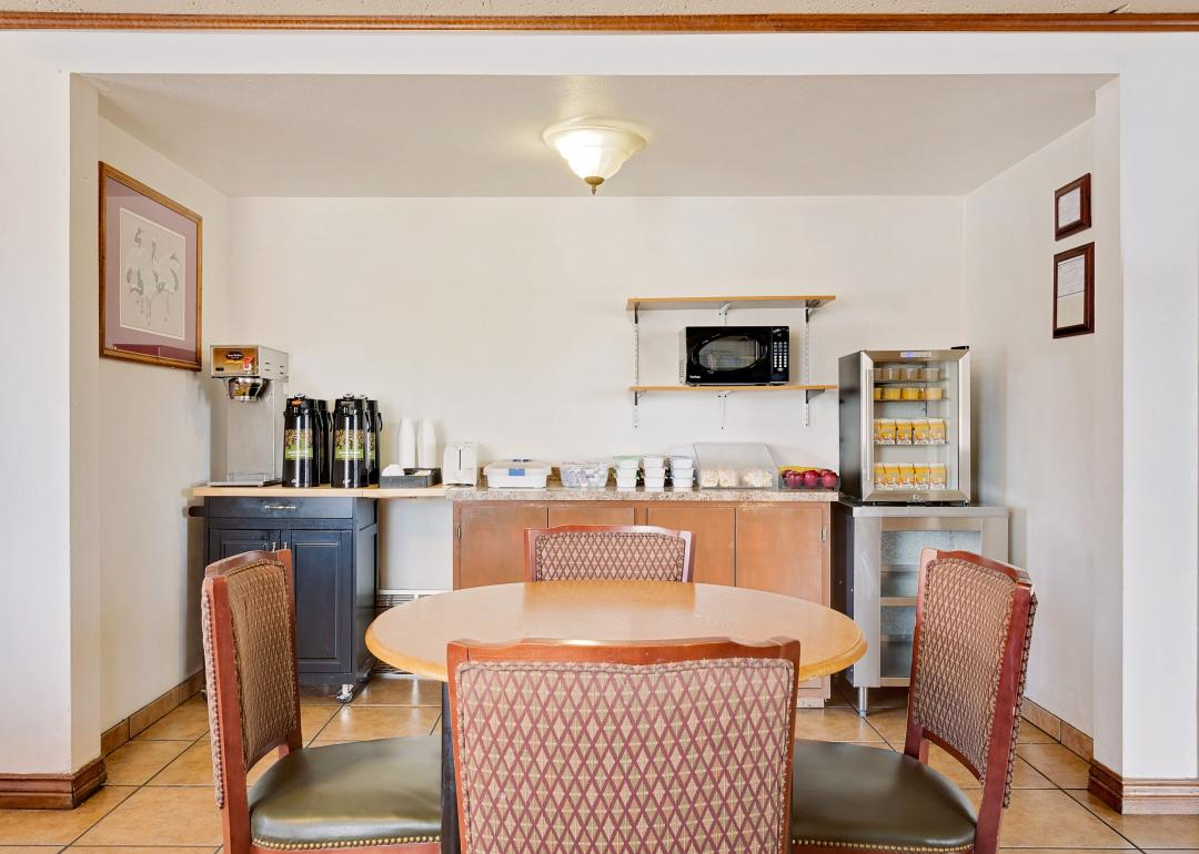 Breakfast room with breakfast bar coffee station and dining tables