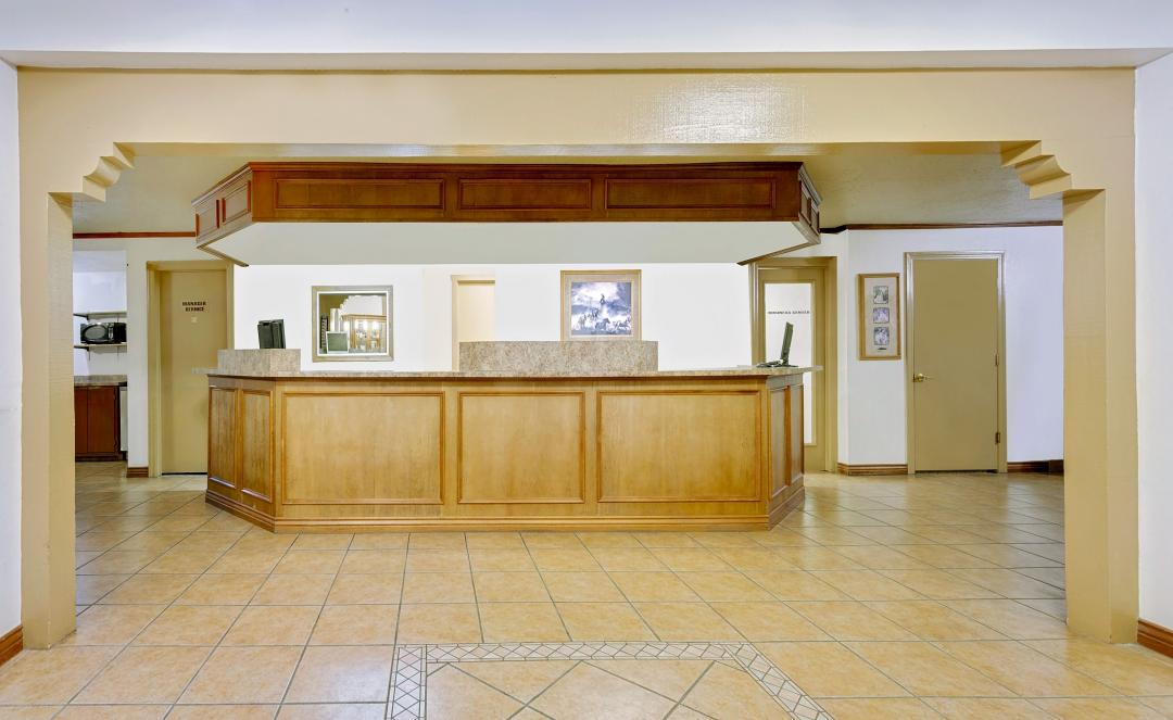 Front desk and lobby area with tiled floors