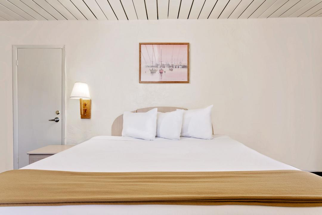 Guest room with king bed and three pillows