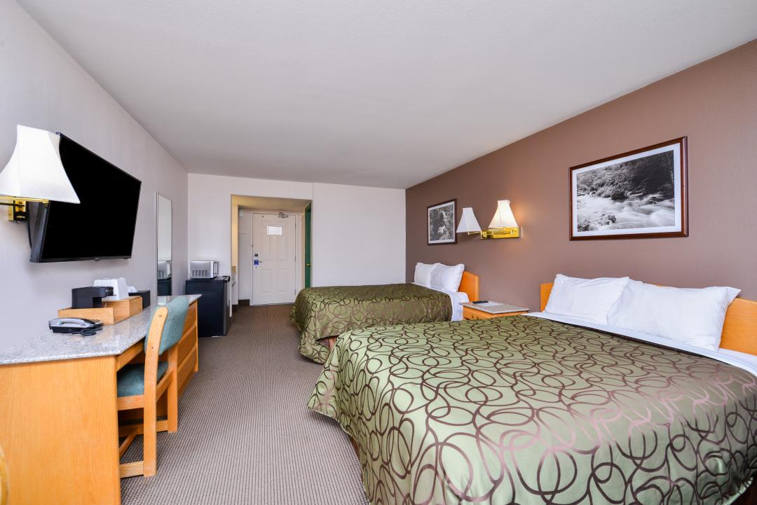 Spacious two queen guest room with desk, fridge and flatscreen TV