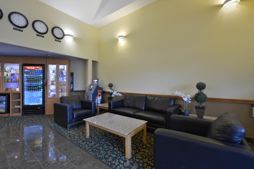 Spacious lobby with guest seating and vending machine