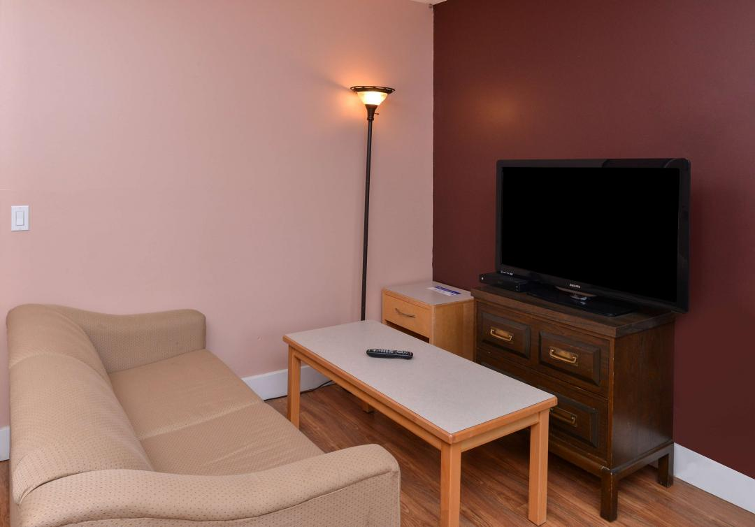 Suite Amenities wit chouch, table and flatscreen TV