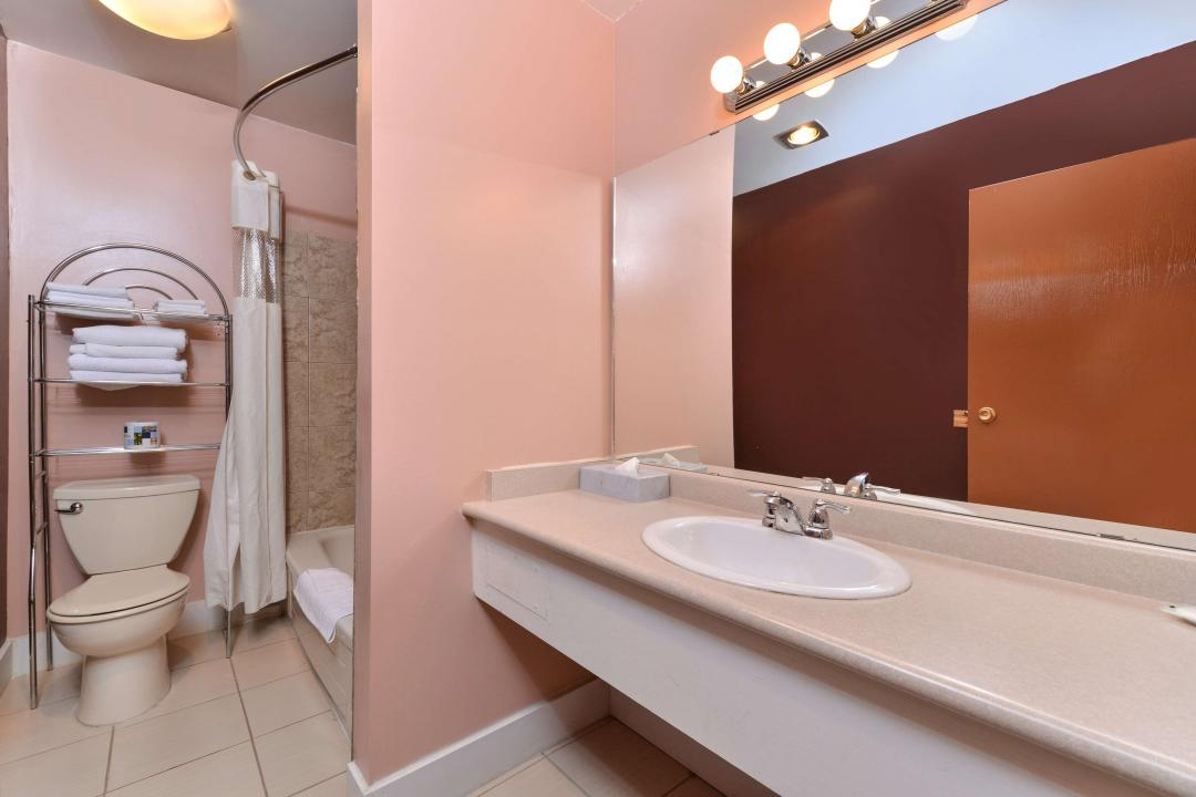 Clean and spacious guestroom showers and tub