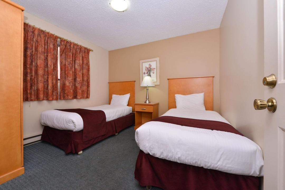 One Queen Two Twin Beds Suite