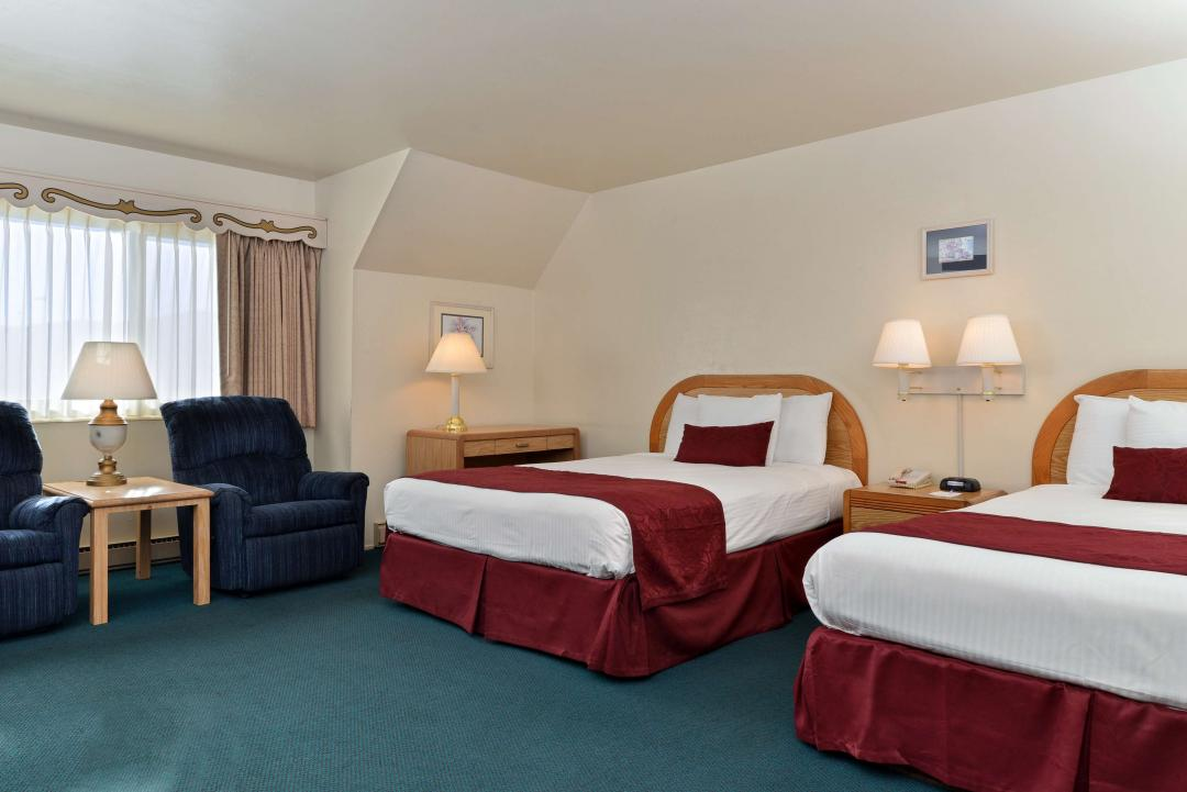 A view of our spacious Two Double Beds guest room.