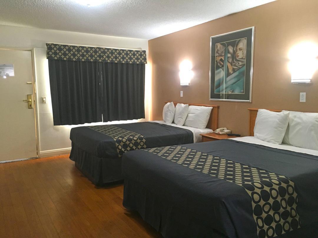 Two Queen Beds with Hardwood Flooring