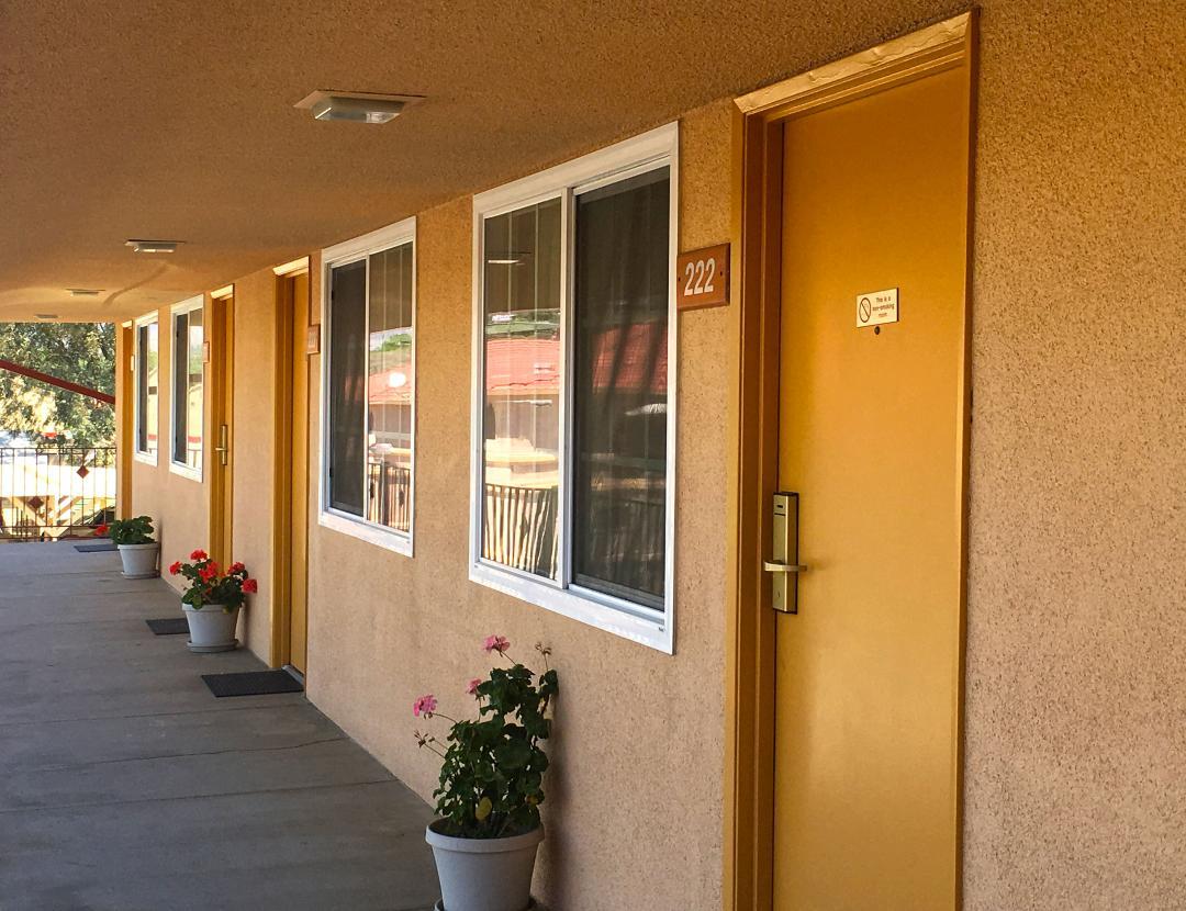 Sunny view of guestroom exterior corridor