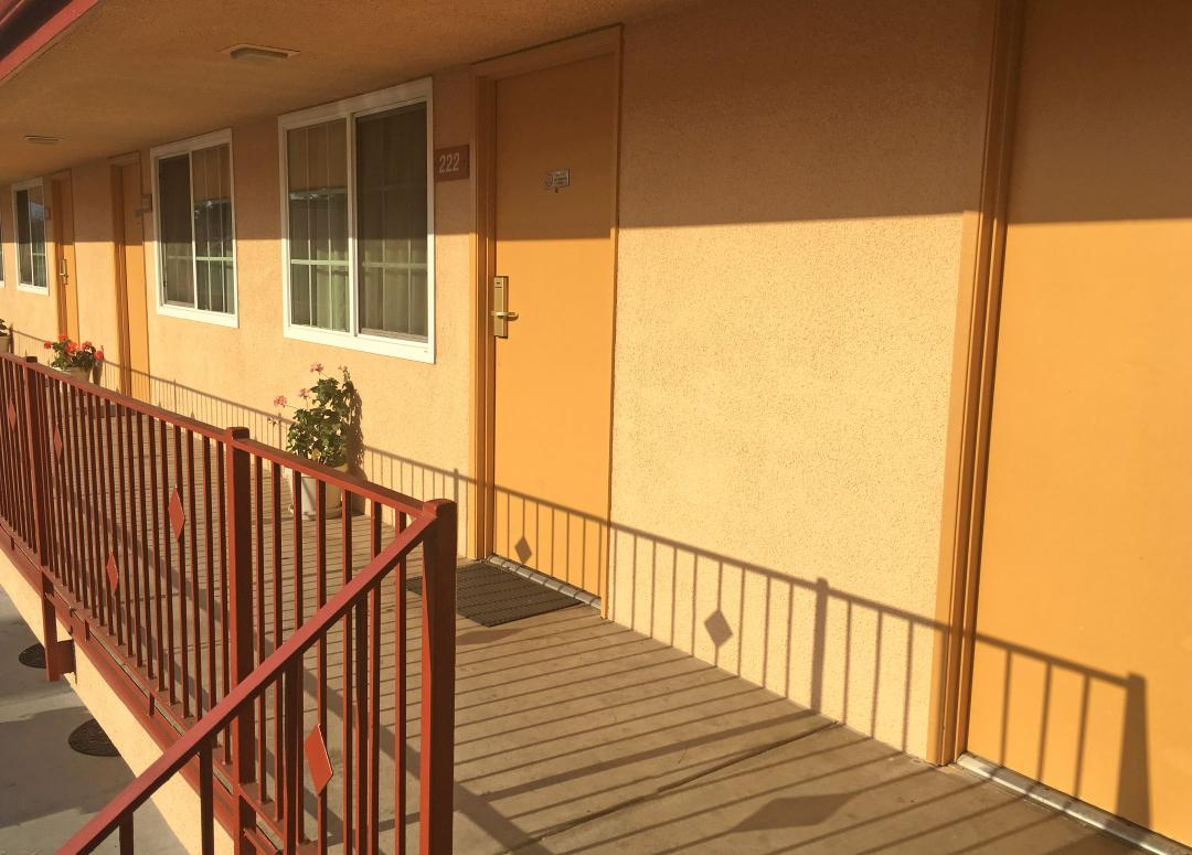 Sunny View of exterior corridor extrance to guestrooms on second floor