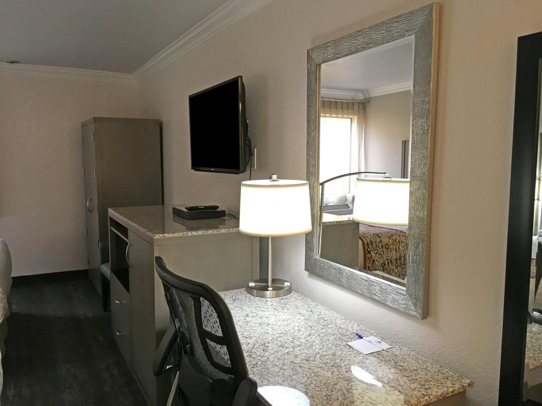 Amenities including, Flat Screen TV, Desk, Dresser and Microwave