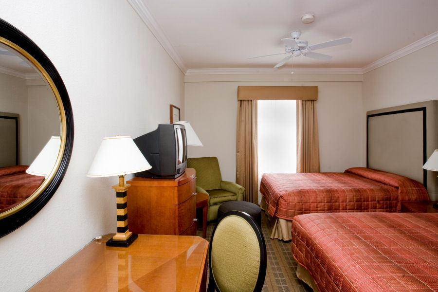 Two bed guestroom with natural light and modern amenities