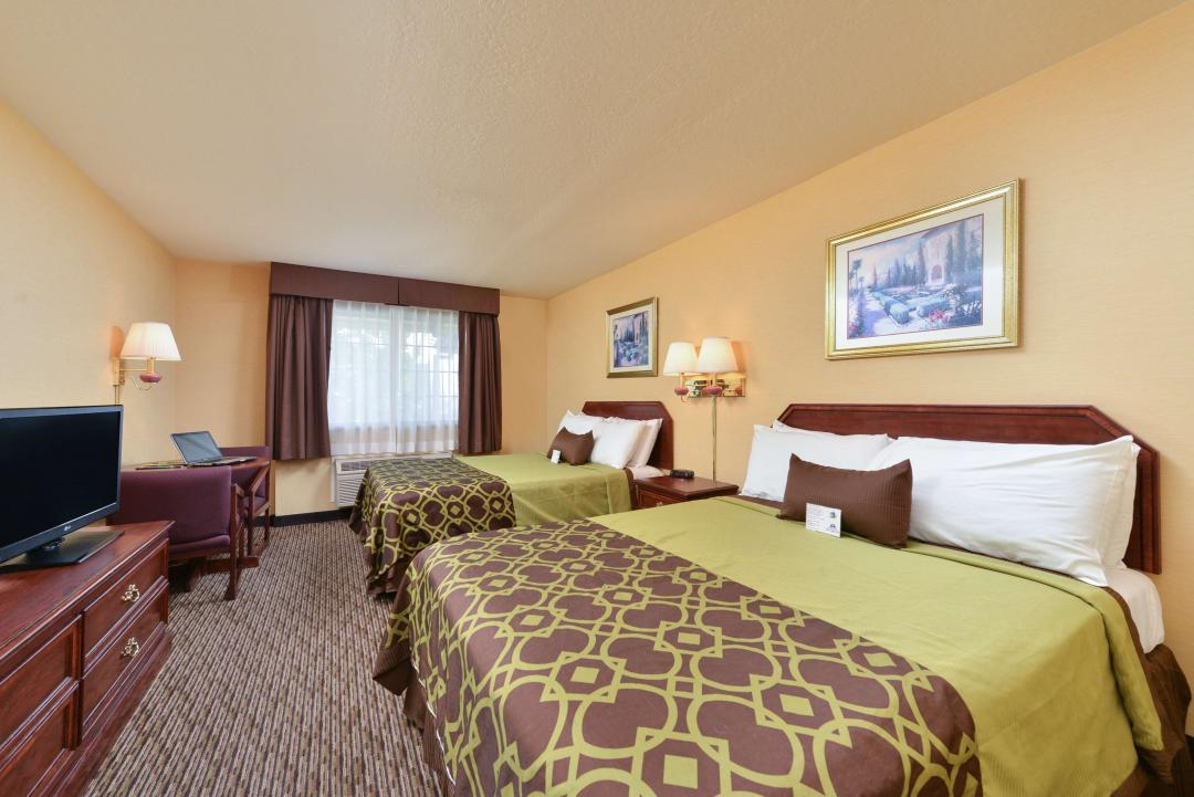 Clean spaciouse two queen guestroom with wooden amenities