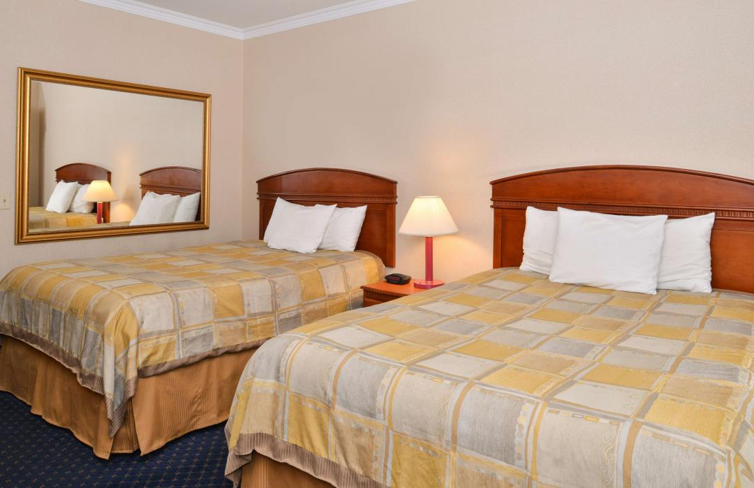 Spacious two bed guest room with mirror