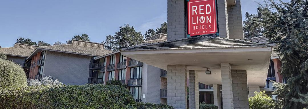 Hotel exterior with Red Lion Hotels sign