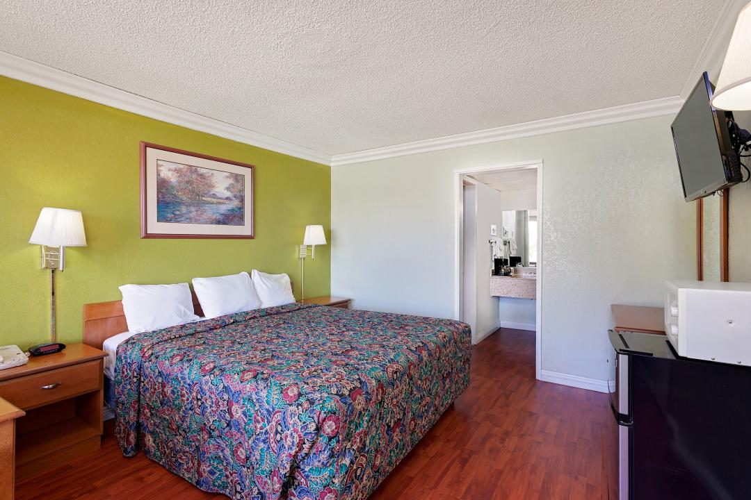 Spacious King Guest Room with Flat Screen TV, Microwave and Fridge