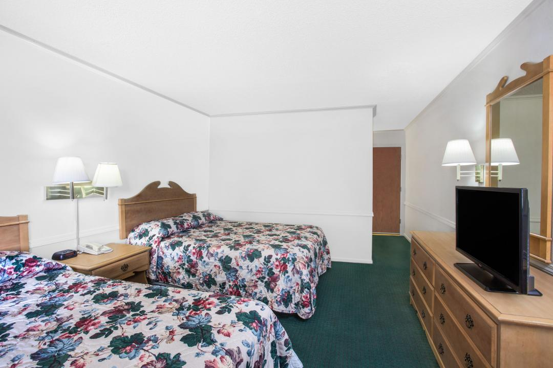 Two queen guest room with dresser and TV