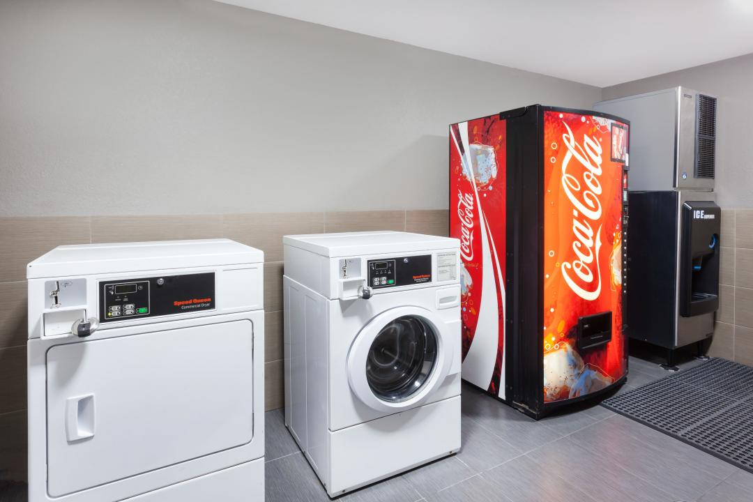 Guest laundry facility with coin-operated washer and dryer, soda vending machine and ice machine