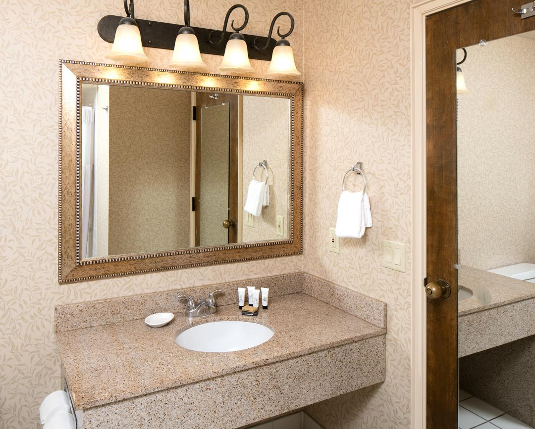 Clean, modern and well lit guestroom bathroom vanity