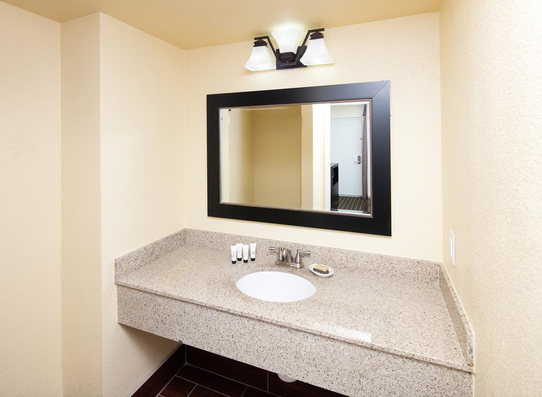 Clean, modern and well lit guestroom bathroom