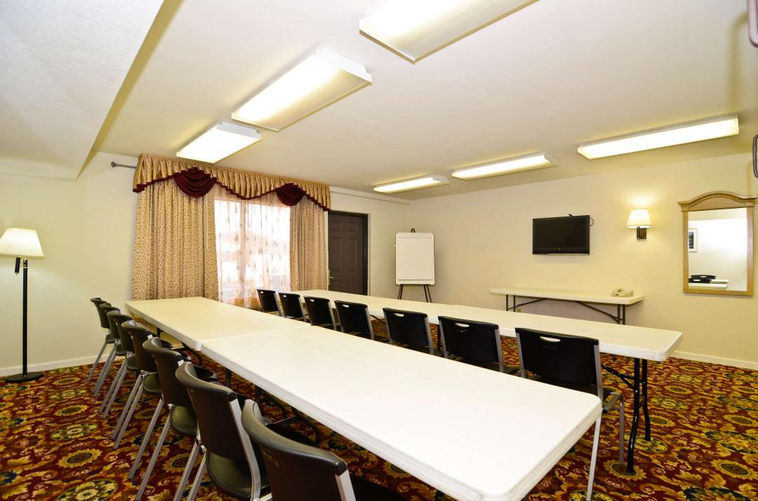 Conference room with two long tables and multiple chairs