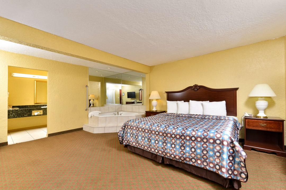 Spacious king bed guest room with Jacuzzi