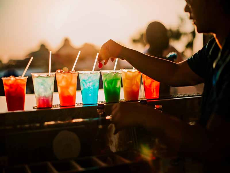 colorful drinks at sunset