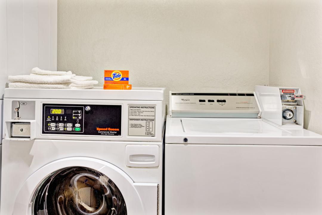 Guest laundry facilities with coin washer and dryer