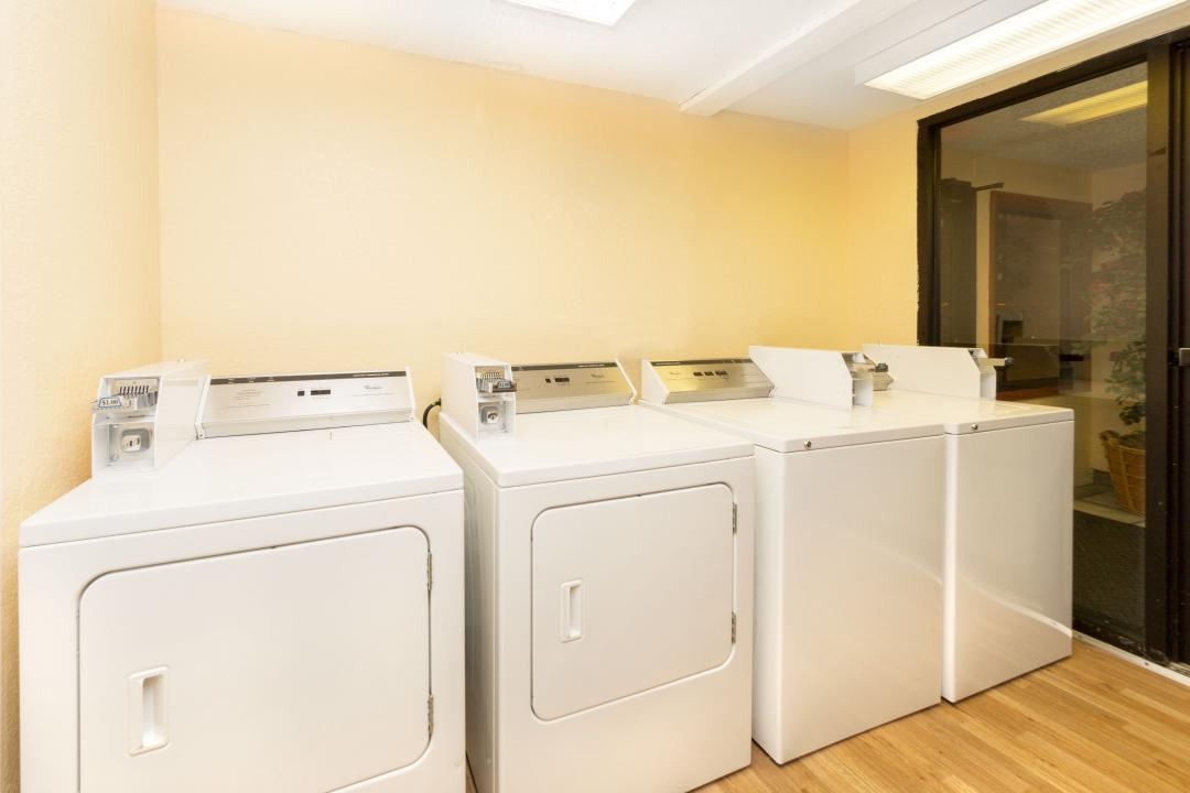 Guest laundry room with coin operated washers and dryers