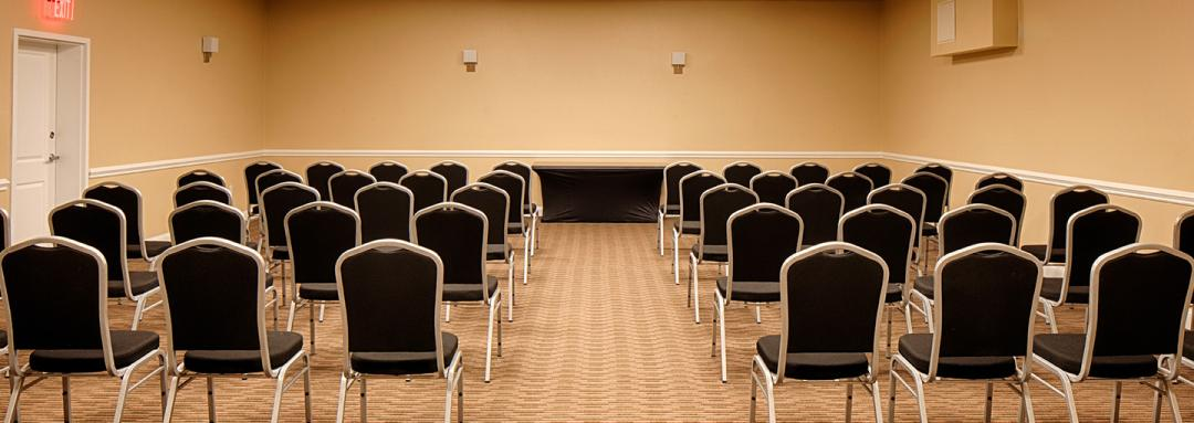 Spacious meeting room with black chairs