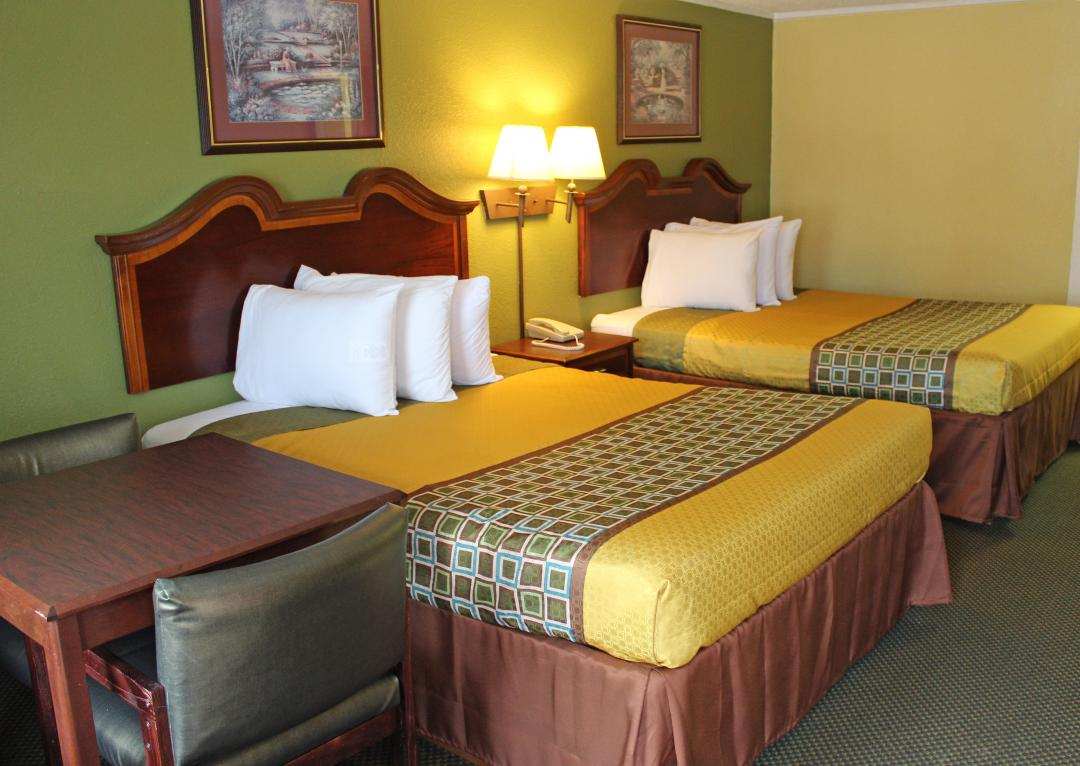 Comfortable guest room with two queen beds