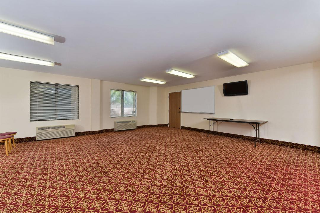 empty conference room with white board on wall and one table