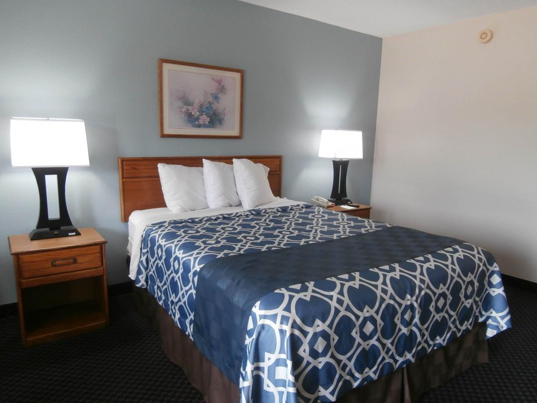 Guest room with one queen bed and two nightstands