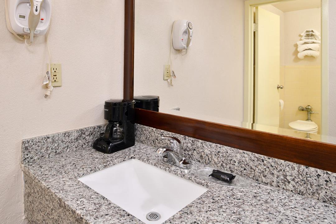 Bathroom vanity with hair dryer and coffee machine