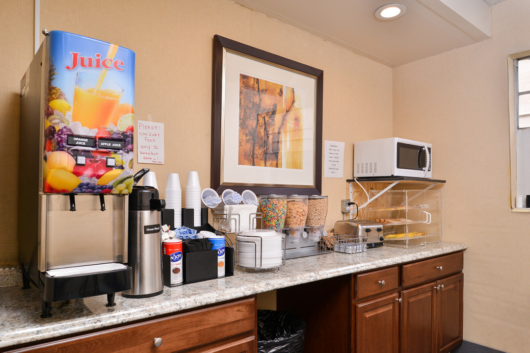 Breakfast bar with juice, coffee, and food options