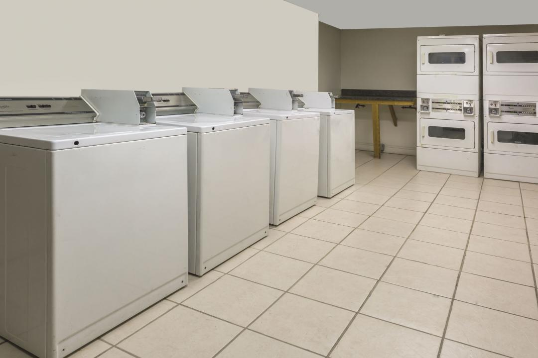 Guest laundy area with four washerz and four dryers