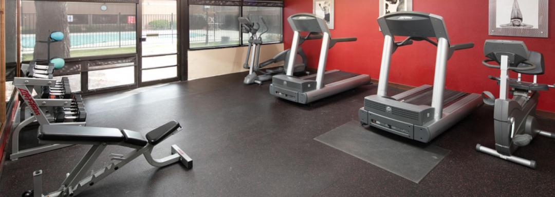 Fitness center with trewadmills weights and elyptical trainer