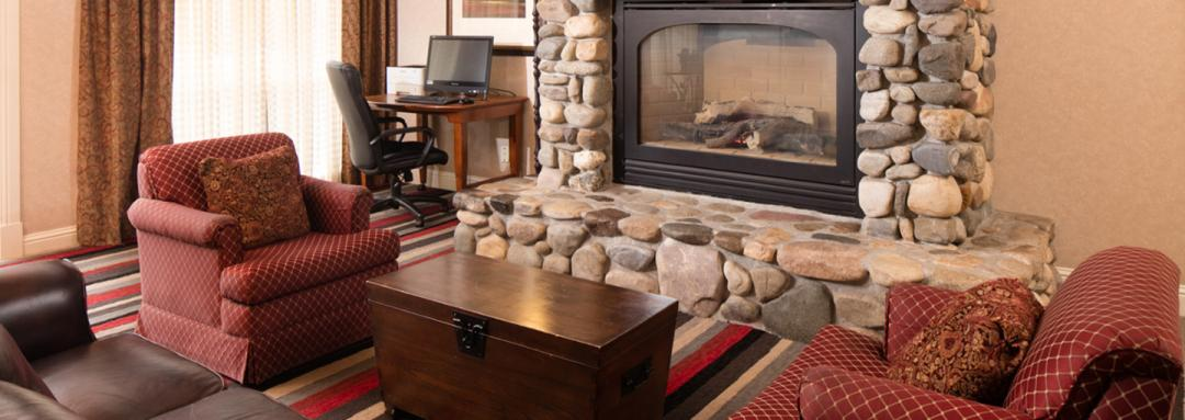 Lobby lounge area with stone fireplace