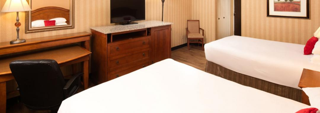Guest room work desk next to TV console