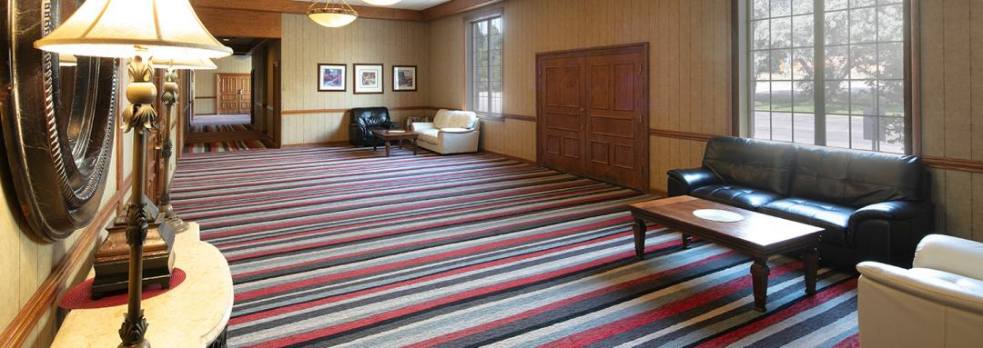 Lobby with lether couches, coffee tables, and open space
