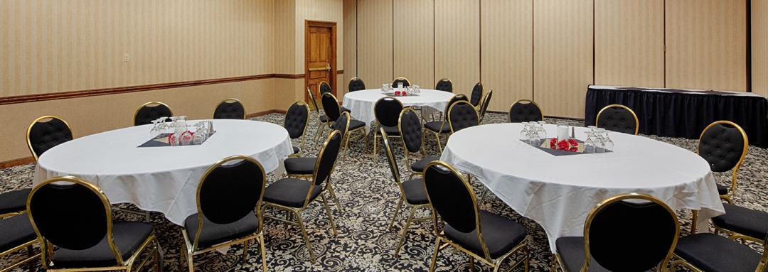 Meeting room with round tables and multiple chairs