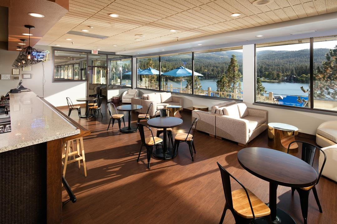 Hotel dining interior with tables and chairs and harbor view