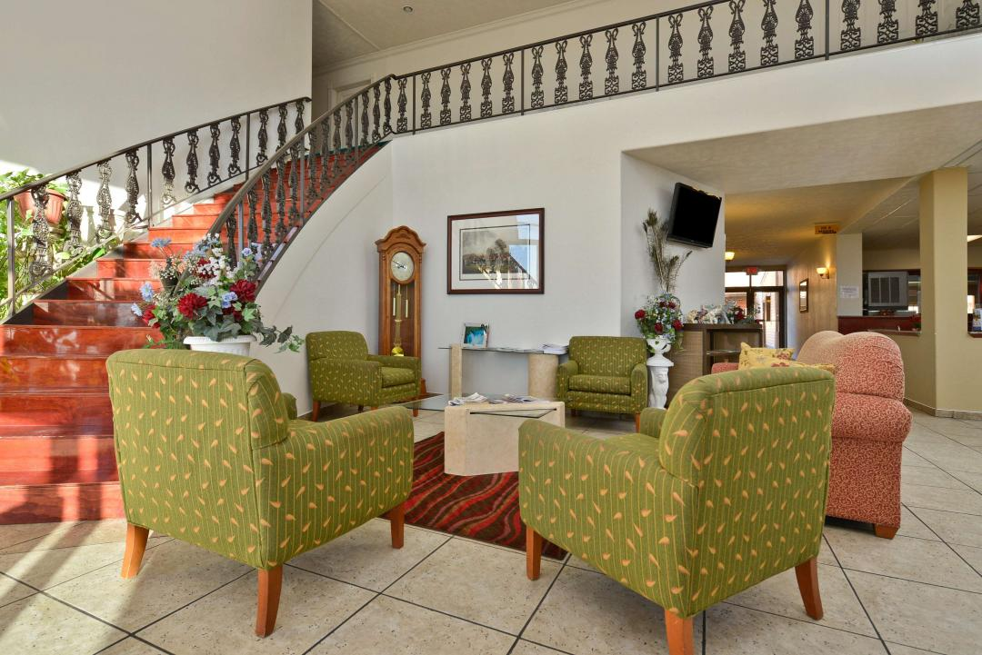 Lobby with spacious seating area, and stairs