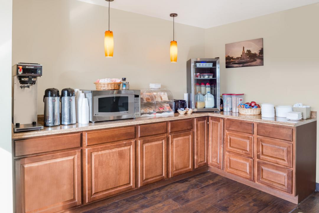 Breakfast bar with coffee, juice, milk, pastries and microwave