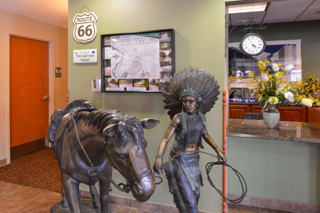 Front desk with Native Indian statue and horse
