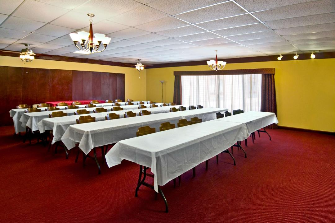 Conference room with multiple tables and chairs