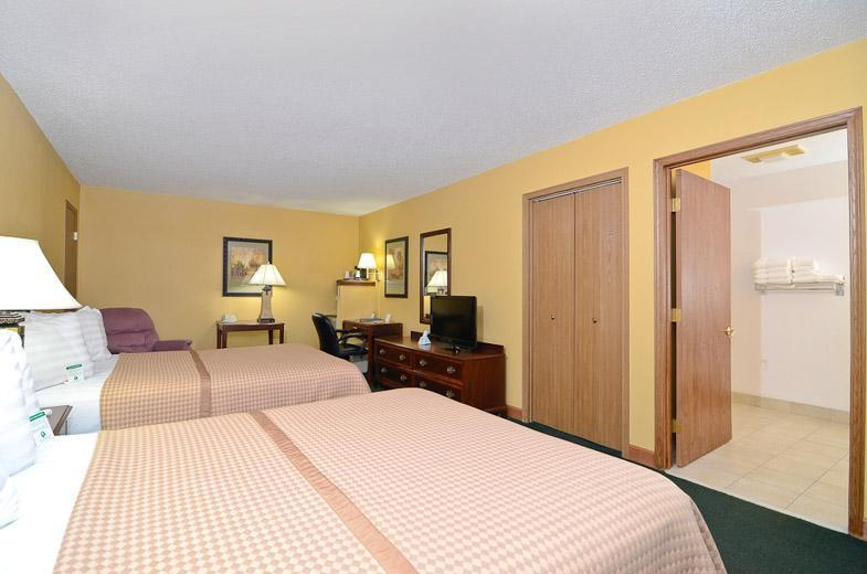 Two queen beds with room amenities and seperate bathroom