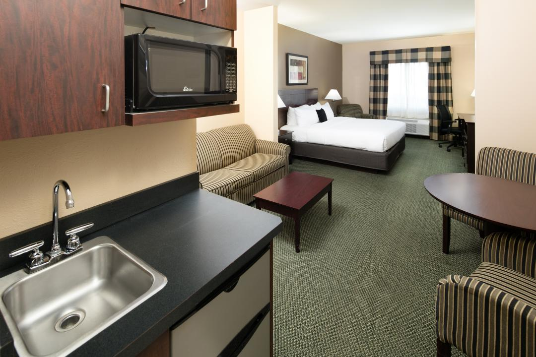 Suite with sink, microwave, sitting area