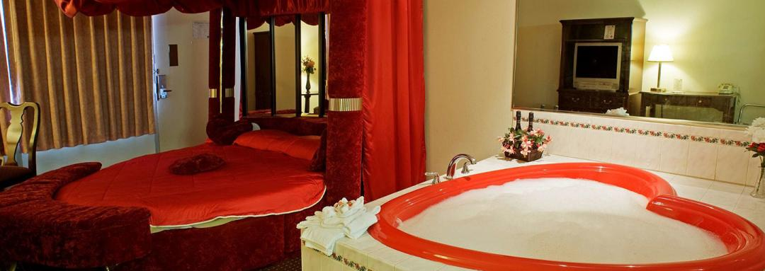 Guest suite with heart shaped jacuzzi tub